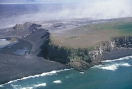 Oblique aerial photo of Ingolfshofdi volcanic headland anchoring eastern end of Skeidararsandur