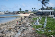 A cemetery by the eroded coastline, Majuro, Marshall Islands.