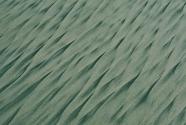 Concentration of black sand in rill marks on beach face, Santa Cruz, California