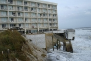 The Comfort Inn at South Nags Head North Carolina during a small storm. The building sticks well out on the beach. Customers assigned to the seaward most rooms should consult a weather forecast before accepting the room! This is the oldest high rise on the NC outer Banks and was originally built well back from the shoreline. Photo: Ray Midgett.