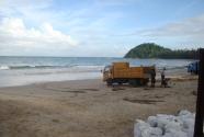 trucks-sand-bags-beach