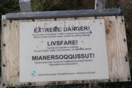 Warning sign above Sermermiut Beach