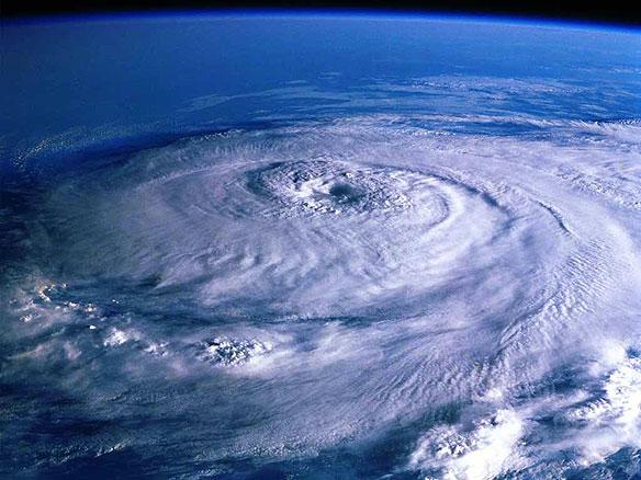 Exploring links between Ocean Warming, Stronger Hurricanes and low-lying coastal zones