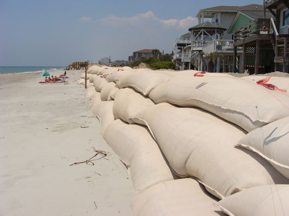 Rows Of Houses With Overling Sandbag Walls Create Huge Problems The Do As Much Damage To Beach Hardened Seawalls