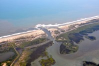 Shore towns use sand dredged from inlets to widen beaches