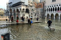 Worst floods for 50 years bring Venice to 'its knees'
