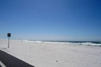Beach asphalt removal project underway; Gulf Islands National Seashore