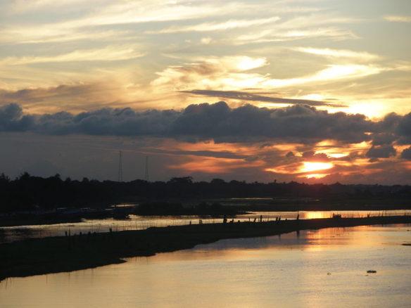 1024px-titas_river_sun_set_view_01