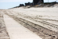 Fishermen, beach builders fight for underwater sand hills
